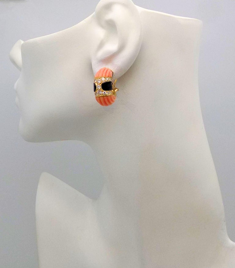 Carved Pink Coral, Black Onyx and Diamond Clip Earrings In Excellent Condition For Sale In Dallas, TX