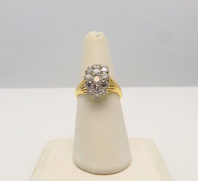 Stunning 18 Karat Yellow Gold Cluster Ring featuring 16 Round Brilliant Diamonds 2.00 Carat Total Weight; VS2-SI1, G-H; Finger Size 7.5; 3.5 DWT or 5.44 Grams.