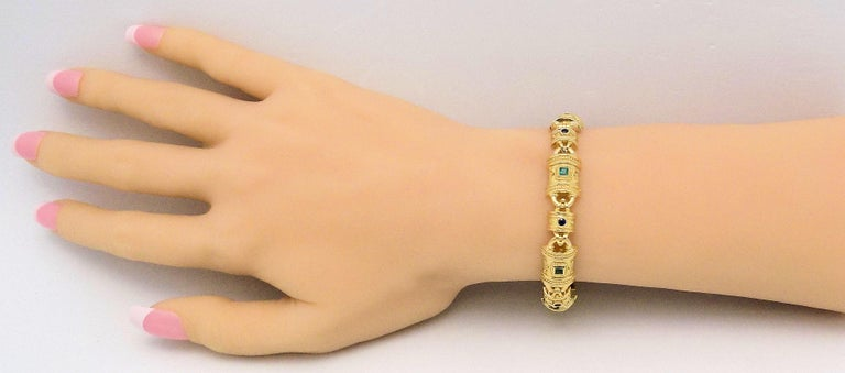 18 Karat Yellow Gold Bracelet with Bead and Twist Detail featuring 6 Square Cut Emeralds 3 X 3 MM, 6 Round Cut Sapphires 2.5 MM, 7