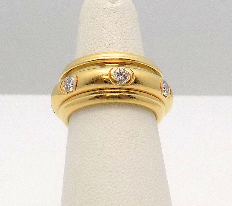 Women's or Men's 18 Karat Yellow Gold Diamond Band by Piaget, Possession Rolling Style Ring For Sale