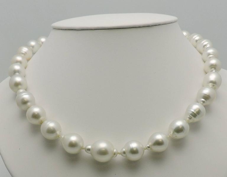Brilliant silvery white luster, very bright. That color everyone wants.    Measure 12.6 x 16 mm.  27 Pearls. 18K wg clasp set with 0.35 ct. tw in round diamonds SI, H. Measurement with clasp 20 inches.  Clasp measures 2 inches.  Simple foldover