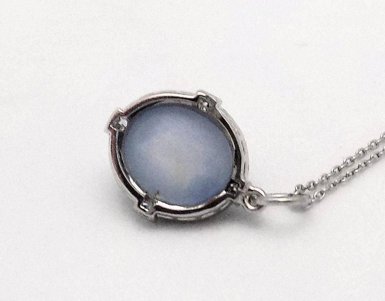 Women's Antique Art Deco Platinum Star Sapphire, Diamond and Black Onyx Pendant and Chai For Sale