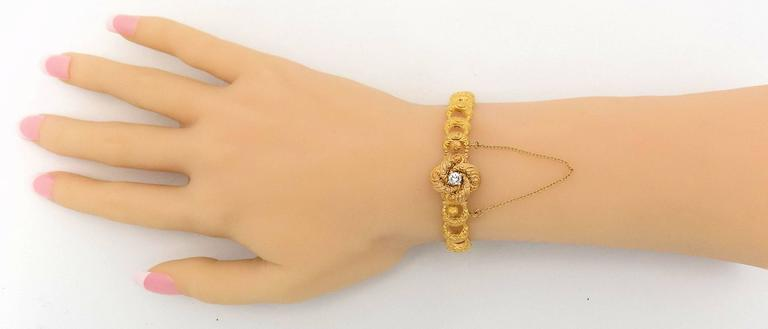 14 Karat yellow gold crescent link bracelet with center diamond.  Manufactured by Krementz, a firm that was in business a hundred years ago.  They were best known for gentlemen's accessory jewelry.    This lovely bracelet is heavily repoussed
