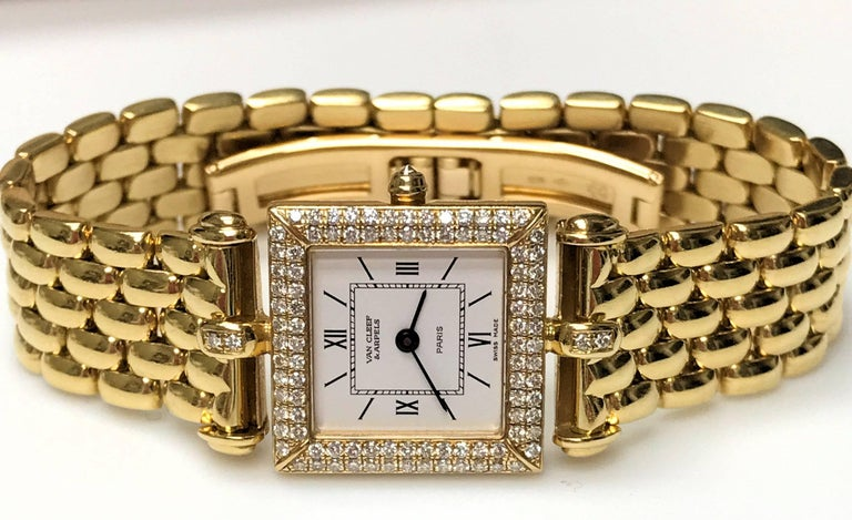 18Karat yellow gold and diamond Van Cleef and Arpels Classique wrist watch.  Five row panther link bracelet with deployant clasp.  100 round diamonds with a total weight of approximately 0.80 carat VVS-2, G. Quartz movement, recently replaced