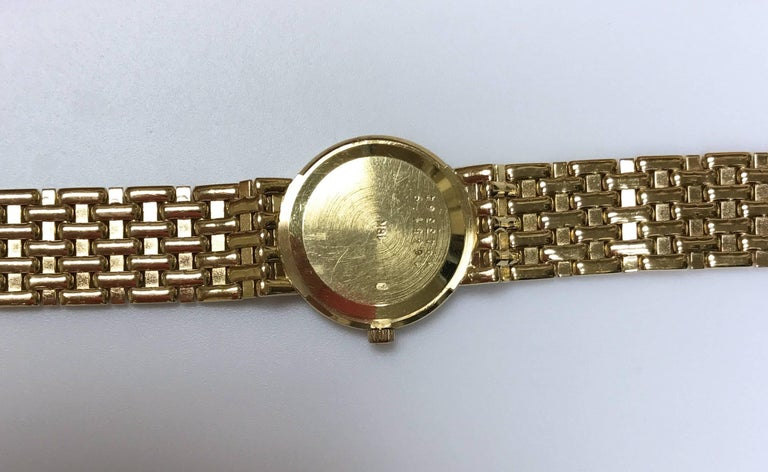 Women's Baume Mercier Yellow Gold Mother-of-Pearl Diamond Dial and Bezel Wristwatch For Sale