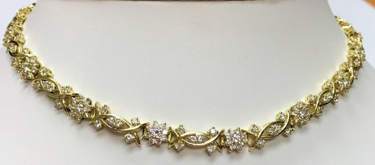 14 Karat yellow gold diamond necklace.  Fleurette motif links with separating links set with diamonds  There are 237 round brilliant cut diamonds 3.85 carats total weight of grade SI, H-I.  Measures 15.5 inches long. Moves beautifully, hugs the