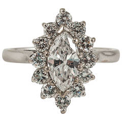 Marquise cut diamond ring with diamonds surrounding