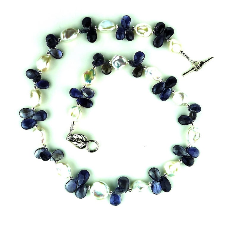 Custom made Blue Iolite Briolettes in threes accented with glowing white Keshi Pearls necklace.  This unique necklace creates a sensation, the iolites are big and bright.  Iolite is a trichroic gemstone.  It will look blue, silver, or yellow