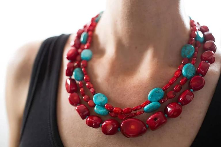 Wow!  This is a great Southwest look Necklace.  Wear this casually with jeans.  This handmade necklace will just as easily go out in the evening for cocktails and dinner.  Triple (3) strand natural highly polished red Coral enhanced with Magnesite