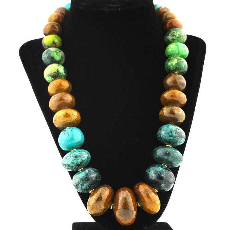 Graduated highly polished magnificent colors of Natural Turquoise enhanced with small gold tone accents.  These colors were carefully hand selected to compliment one another.  This is a unique handmade necklace..It's a lovely 22.5  inches long,