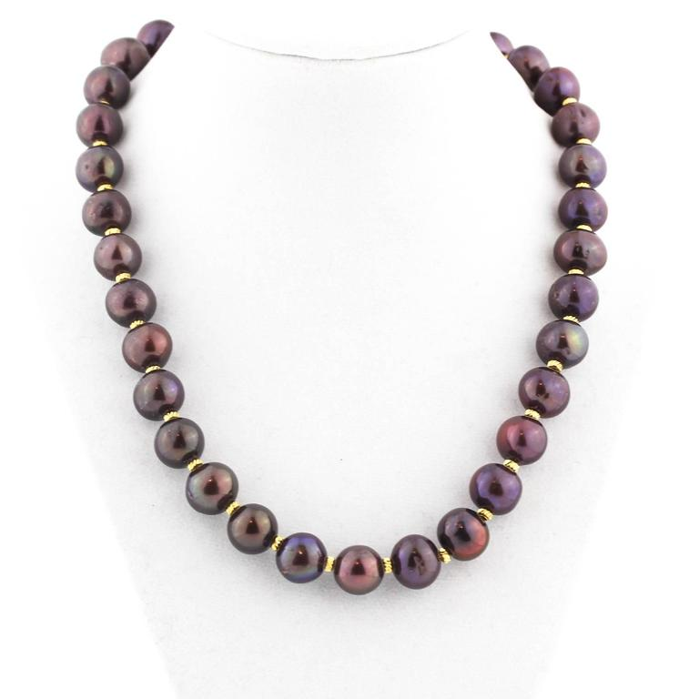 These real cultured Pearls glow chocolate and wine colors and are enhanced with goldy accents Size:  approximately 13 mm Length:  19 inches Clasp:  gold plated