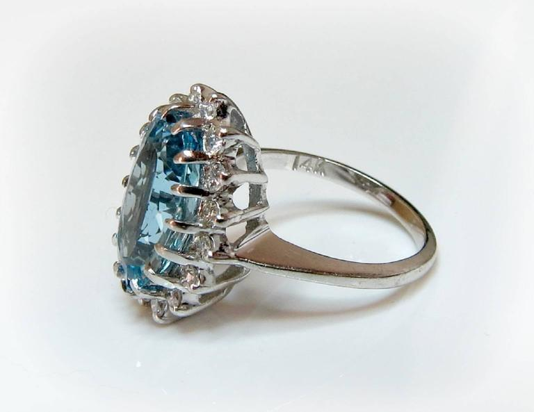 4.25ct Aquamarine ring with .25ct (total weight) Diamonds is sure to turn heads. Beautifully faceted, the aquamarine stands center-stage. It is surrounded by a ballerina halo of diamonds and is reminiscent of Princess Diana's famous engagement