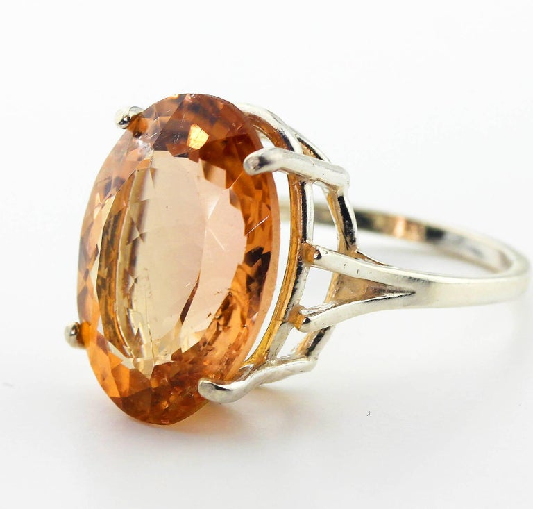 Glittering bright translucent 12.75 Carat Brasilian peachyorange Tourmaline from the famous mines in Minas Gerais, Brasil.  The gemstone is set in our unique handmade Sterling Silver ring size 7 (sizable).   More from this seller by putting gemjunky