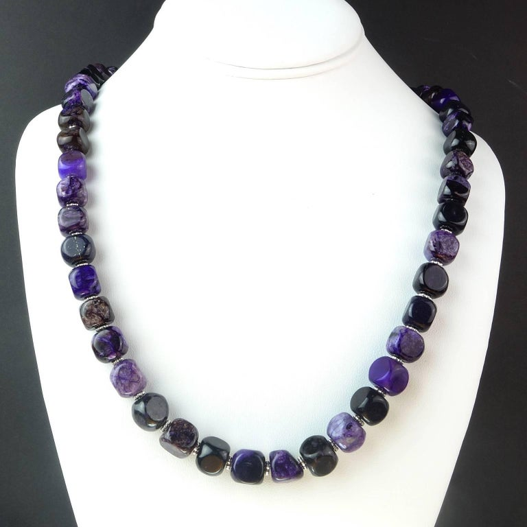 24.5 Inch necklace of softly rounded, Amethyst matrix cubes, approximately 9MM.  Each cube is unique in intensity of color and matrix. The Amethysts are enhanced with fluted silver tone accents. The clasp is a Sterling Silver hook and eye.