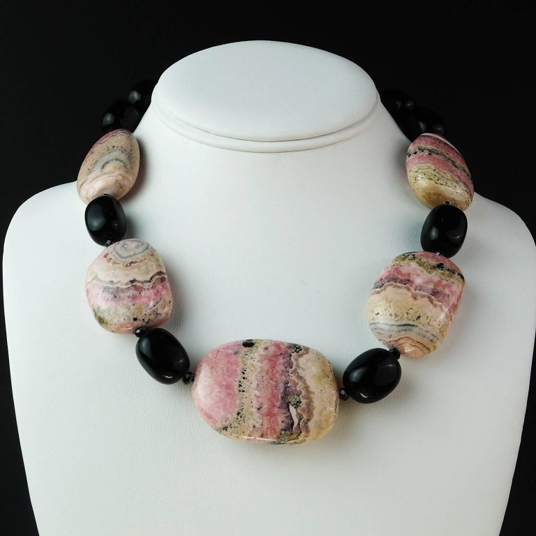Necklace of five gorgeous tablets of highly polished Argentine Rhodochrosite with lovely matrix and sparkling Black Onyx. The necklace is 18.5 inches in length and if you like Rhodochrosite, this is your necklace! It is secured with a Sterling