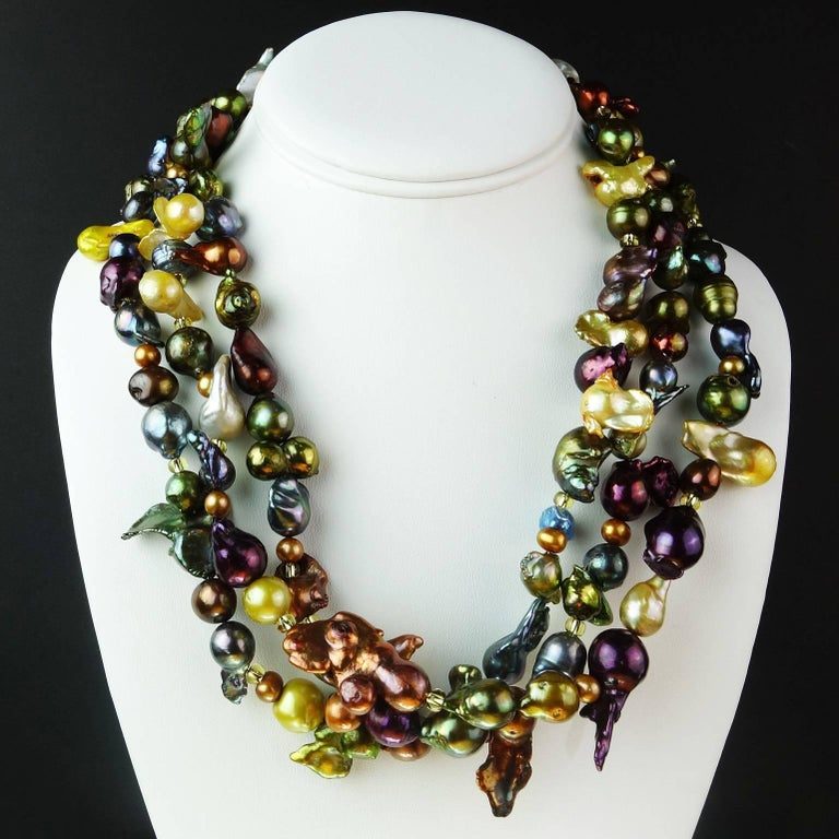 Multi shape, multi color, multi size Pearls in a custom made three strand necklace that will knock your socks off! This jewel tone necklace is so much fun you will want to wear it every day. Every pearl is a delight.  There are gold Czech beads