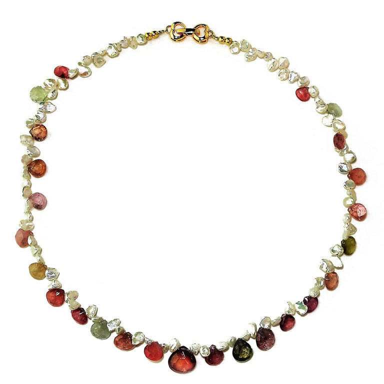 Custom made 17 Inch Choker Necklace of Graduated fat Pear shaped Sapphire Briolettes and delicate freshwater white keshi pearls. The Sapphires are graduated from 6mm to 11mm and are in shades of pink, light green, and clear. They have all the