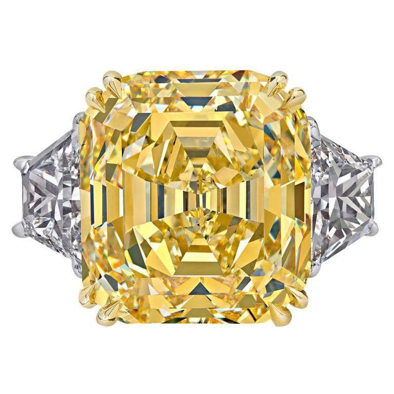 GIA Certified 14.36 Carat Fancy Intense Yellow Emerald Cut Diamond Ring For Sale