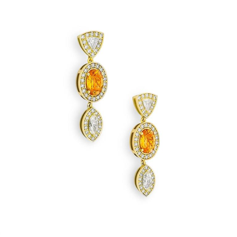 Inspired by the striking plumage of the Raggiana Bird of Paradise, the Empress Earrings combine tropical sensibilities with timeless elegance. Using a classic combination of 4.6 tct orange garnets, 1.3 tct natural marquise and trillion cut diamonds