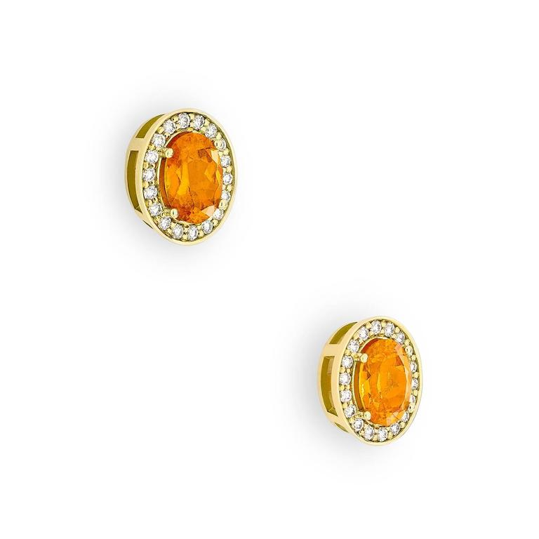 Fiery and bright, these delicate Empress Orange Studs are every way as vibrant and bold as the tropical bird that inspired them. Set with 4.6 tct orange garnets surrounded by 0.21 tct natural pavé-set diamonds, the Empress Orange Studs are