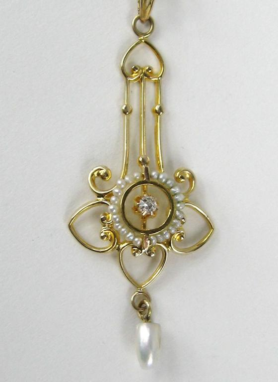 Truly superb Victorian era lavalier circa 1880s hand crafted beautifully in yellow gold Accent Diamond surrounded by petite seed pearls  Stunning piece  Measuring  Chain is 19.25 in end to end  Lavalier is 1.66 in long x .61 in wide  Any questions