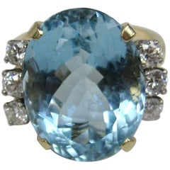 Ladies GIA Certified 13.13 Carat Oval Aquamarine Diamond 14 Karat Gold Ring