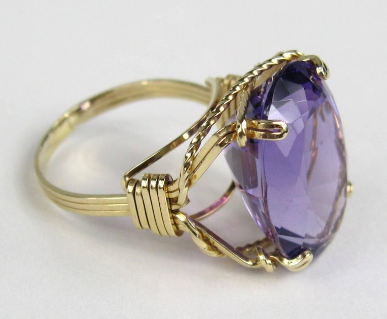Oval Amethyst set in a 14K Gold Setting Approximately 17.25 Carats. Sits .45 in up from your finger. It is a size 8.5 and can be sized by your jeweler or by us.  This is out of our massive collection of Hopi, Zuni, Navajo, Southwestern, sterling