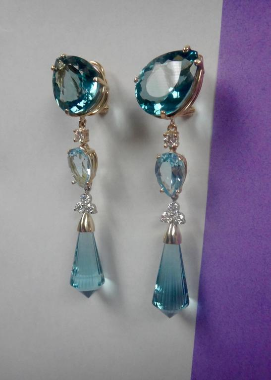 Three Diffe Shades Of Blue Topaz Are Decorated With Diamonds In These Dramatic Dangle Earrings