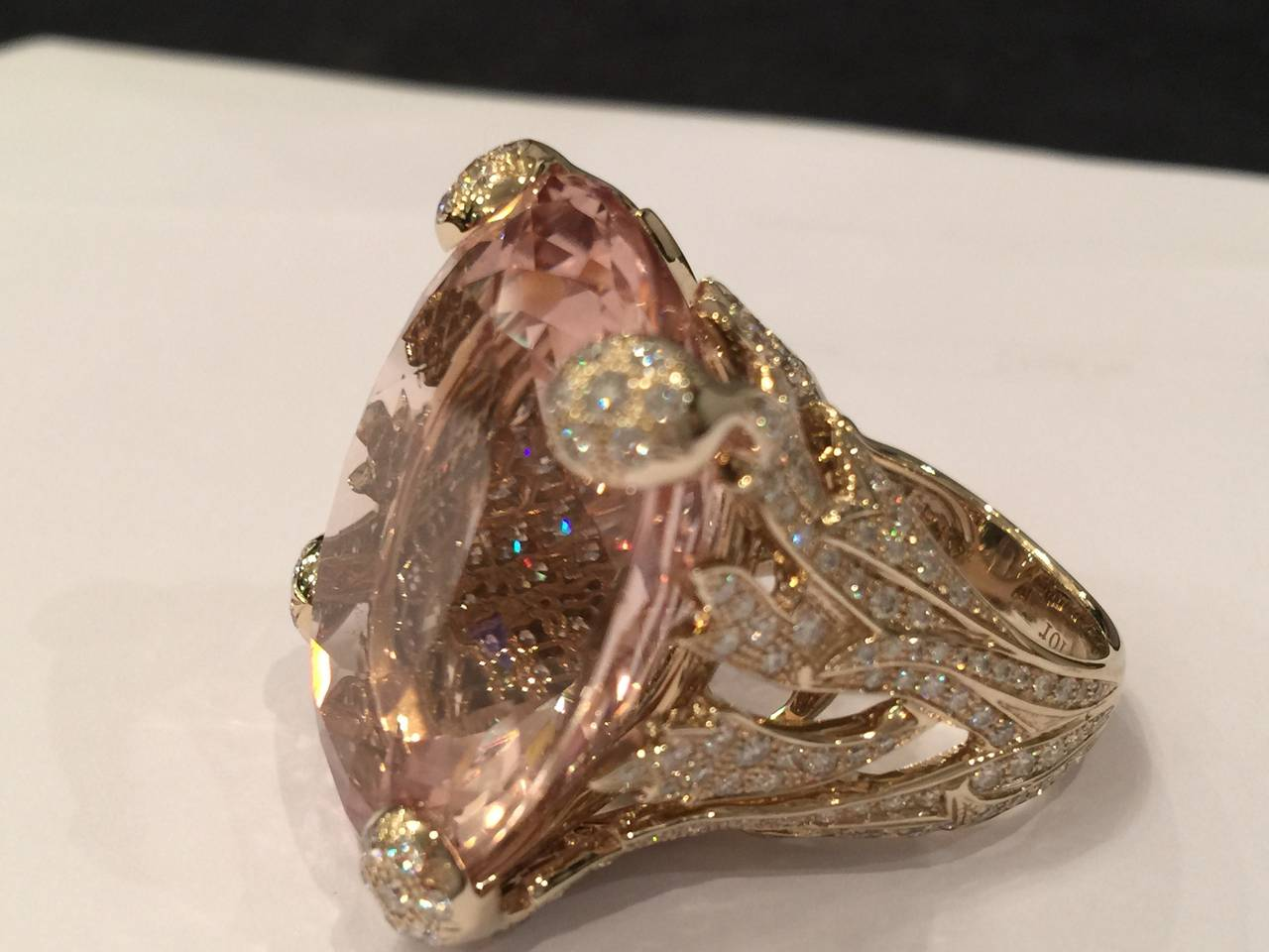 "A natural gold Christian Dior ring set in the middle with a magnificent oval, light pink peach flower color morganite. The ""flame"" design is underlined by a setting of brilliant-cut diamonds. ""Miss DIOR"" collection.