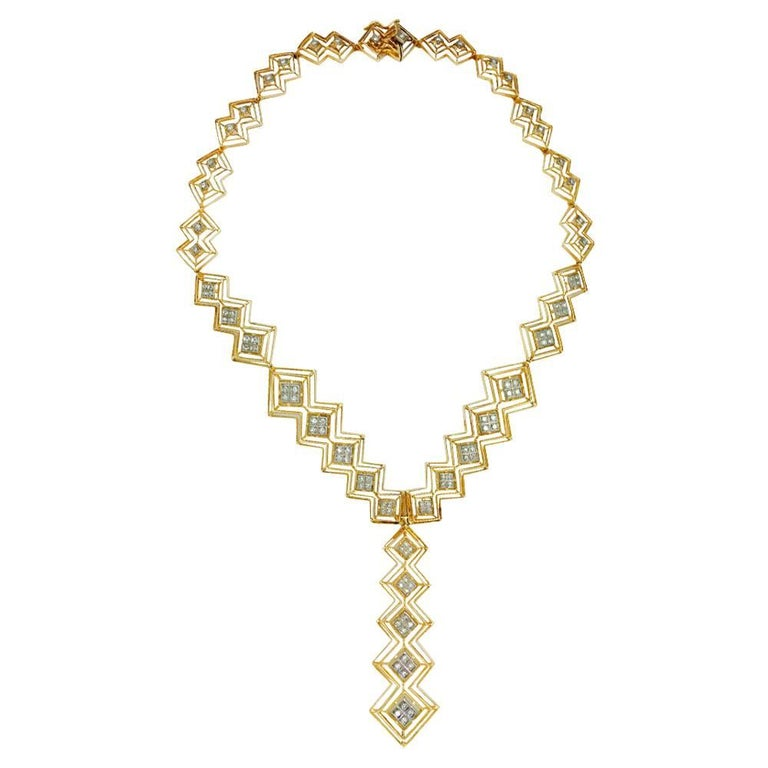 A 750/000 yellow gold Ilias Lalaounis tie necklace made with nine independent open-worked motifs. The motifs are made with two, three or five lozenge, centered with 750/000 white gold lozenge enhanced with one or four 8/8 cut diamonds. Diamond