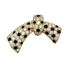 Yellow Gold Van Cleef & Arpels Knot Brooch, Diamonds and Onyx