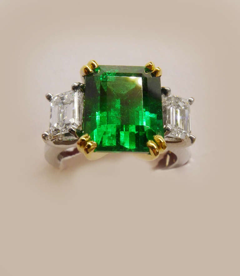 White And Yellow Gold Ring Set With An Emerald Cut Emerald