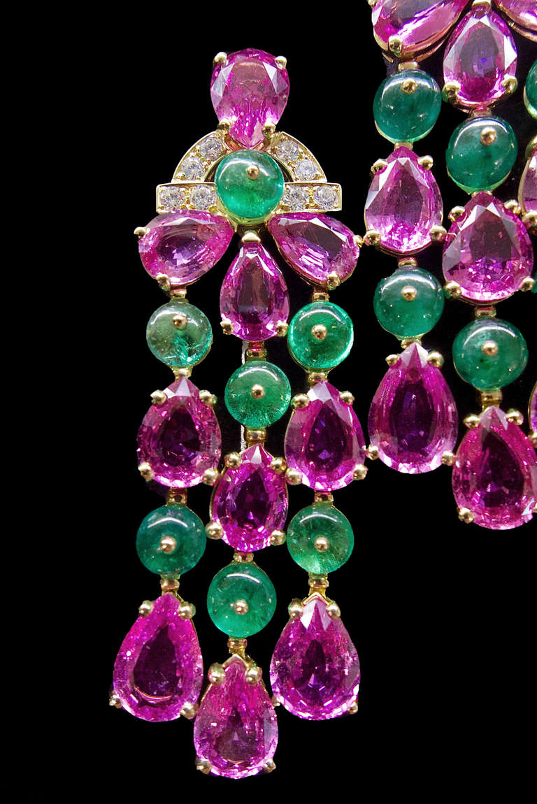 Bulgari yellow gold pendant earrings set with 20 pear-shaped pink sapphires for a total weight of 33.42 carats; with 14 emerald beads for 13.54 carats and brilliant cut diamonds for 0.64 carat.