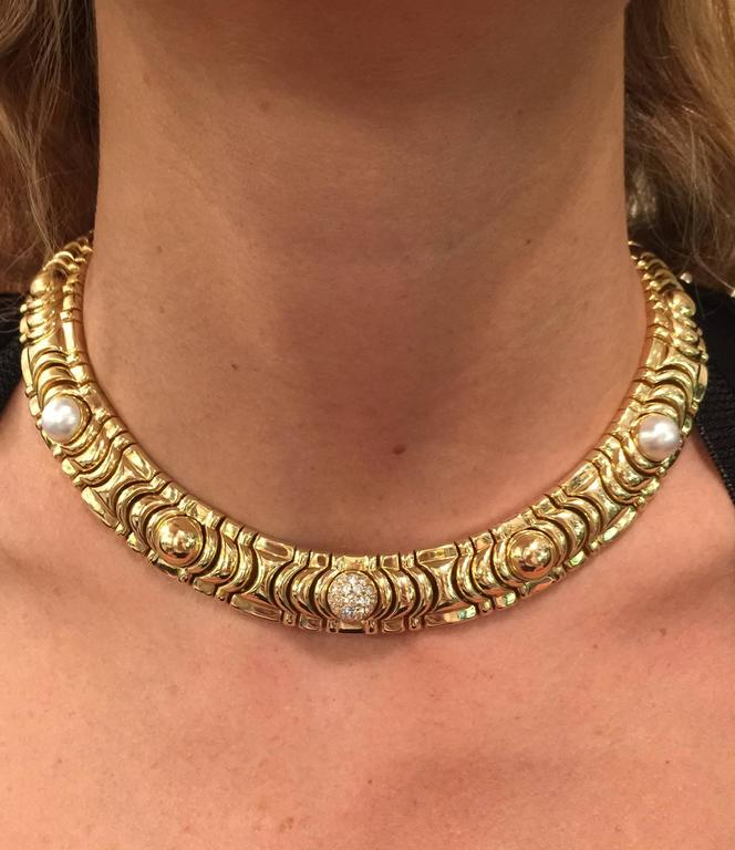 Women's 1990s Piaget Gold Necklace Enhanced with 19 Half Decorative Beads For Sale