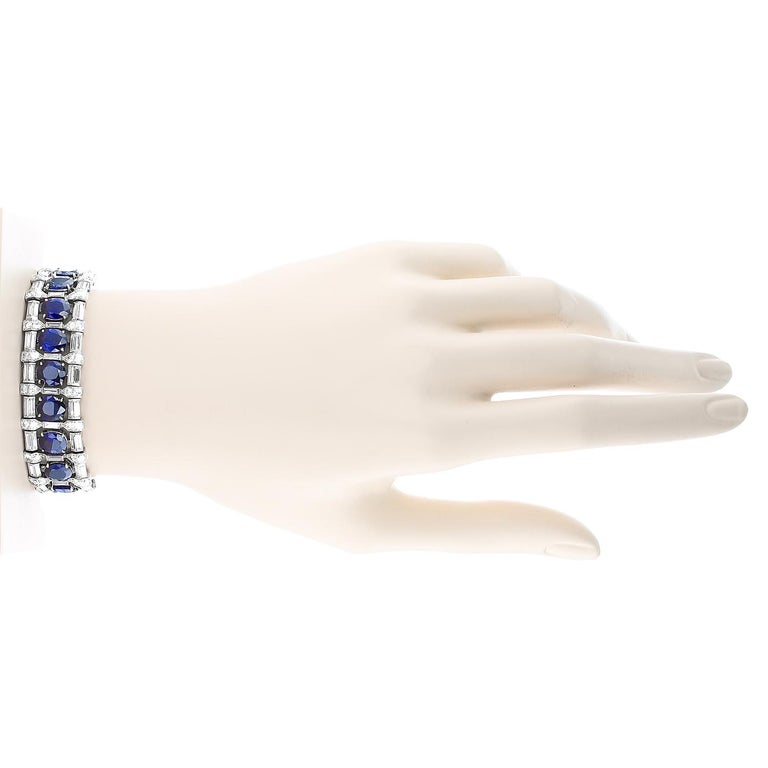 An exceedingly rare and elegant art deco bracelet by Bvlgari set with twenty-three natural, no-heat blue sapphires from Burma (Myanmar), weighing approximately sixteen to seventeen carats, accented with two rows of an alternating pattern of step-cut