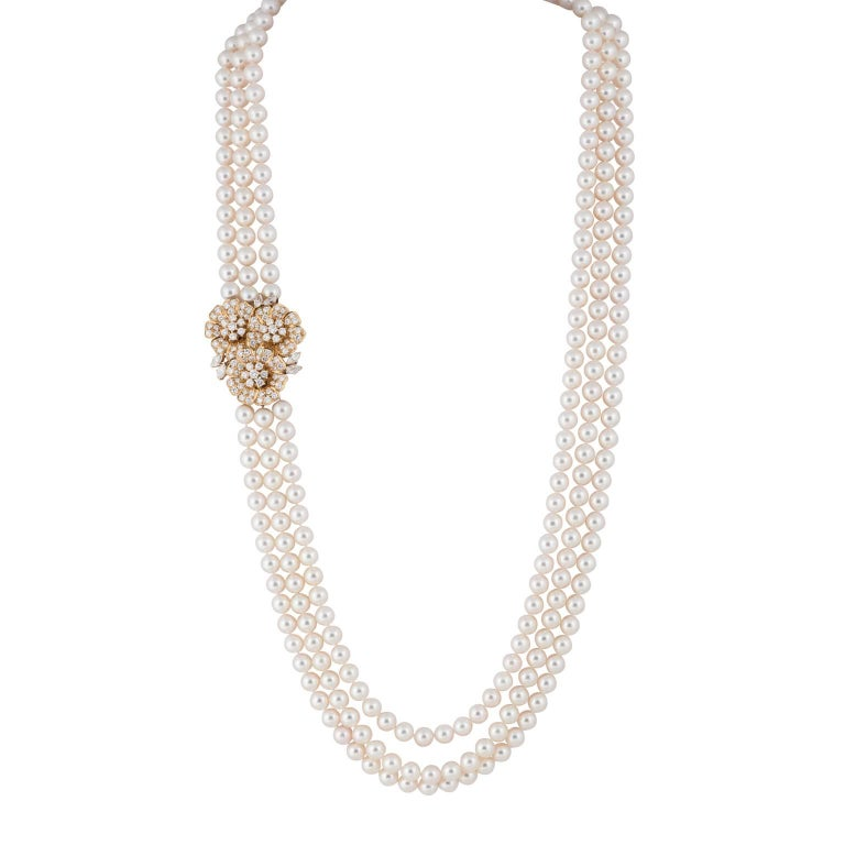 Mikimoto Three-Strand Nesting Pearls with a Diamond Yellow Gold Clasp For Sale