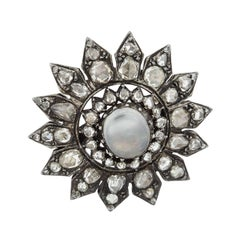 Victorian Era Silver over Gold Cabochon Moonstone and Rose Cut Diamond Brooch