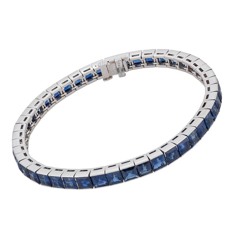 16.60 carats of natural, untreated square cut sapphires, set in platinum and made by Tiffany & Co.  There are 46 sapphires, all uniform in color, and accompanied by a report from the American Gemological Laboratories (AGL) stating that the sapphires