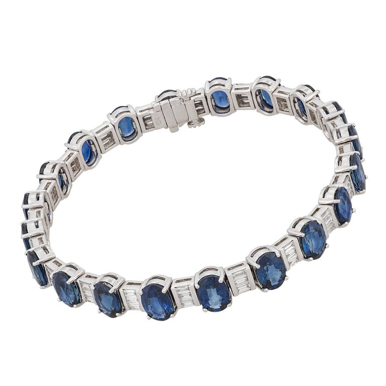20.00 carat oval sapphire and baguette diamond 18 karat white gold bracelet.  The bracelet is designed in an alternating pattern of one oval sapphire between three baguette diamonds.  The 60 diamonds have a total weight of 2.50 carats.  Hallmark:
