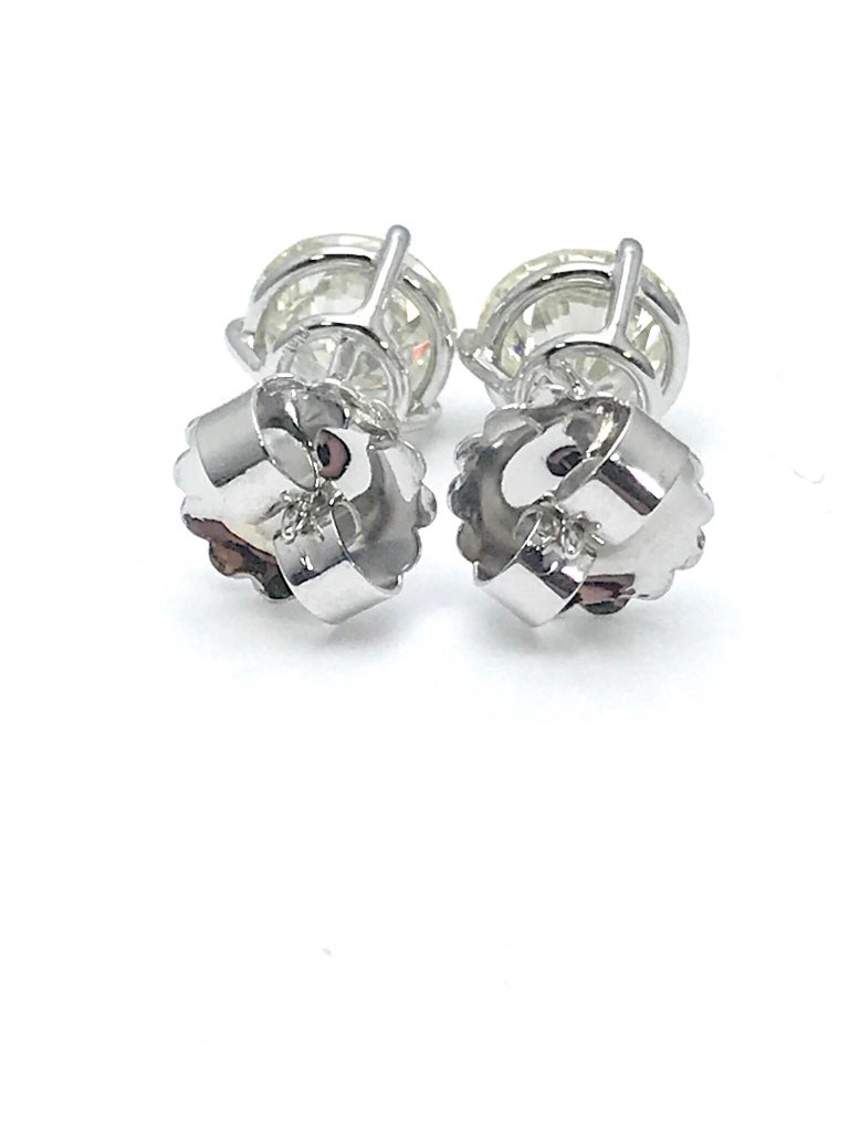 Round Cut 4.51 Carat Total Weight Round Brilliant Diamond Stud Earrings in Platinum For Sale