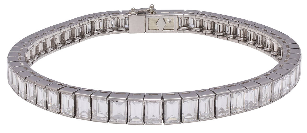 An exquisite emerald cut diamond tennis bracelet.  There are 56 slightly graduated emerald cut diamonds with a total weight of 17.25cts, set in platinum.  The diamonds are F-G color, VS clarity.  This is truly a gorgeous piece of