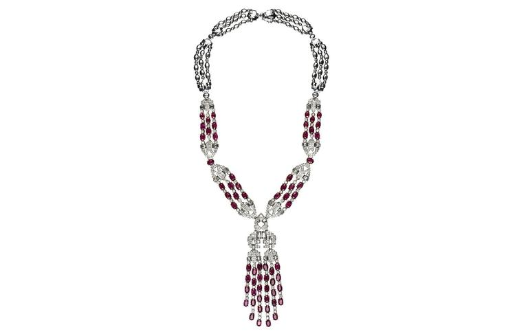 A stunning ruby and diamond 18k white gold lariat necklace.  The necklace contains 64 oval rubies totaling an estimated weight of 30.98cts, with a combination of 414 round brilliant and baguette shape diamonds totaling an estimated weight of