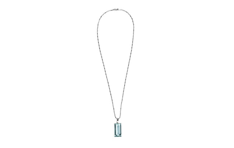 20.58ct emerald cut aquamarine 14k white gold pendant necklace.  The aquamarine is set in a four prong basket, suspended from a bale on a beaded chain.  Length:  18.00 inches Hallmark:  Italy 14K