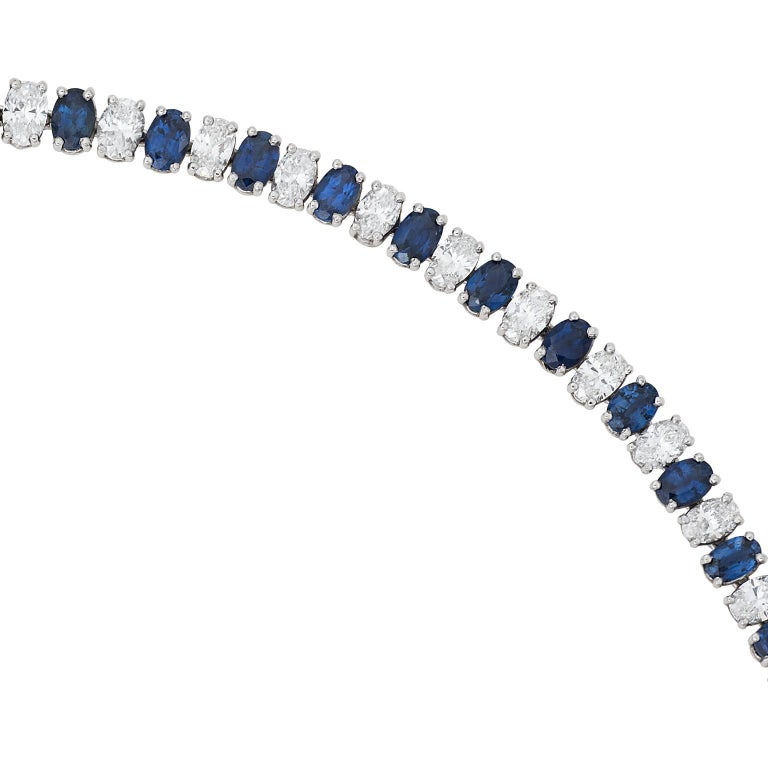Heyman Bros. sapphire and diamond platinum riviera necklace.  The necklace is made up of 66 oval cut sapphires, and 66 oval cut diamonds graduating to the center.  The sapphires have a total weight of 17.46 carats, and the diamonds have a total
