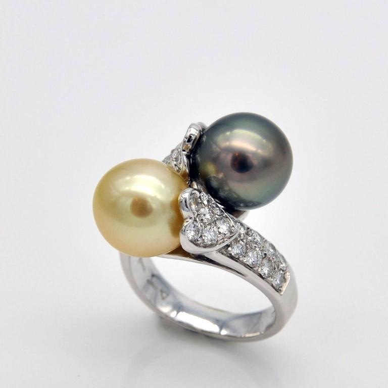 A grey Tahitian pearl and a light golden south sea pearl, set in an elegant