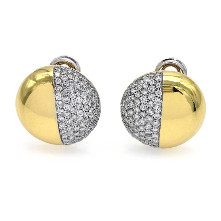 The perfectly simple and modern design of these clip-on earrings makes them both chic and easy to wear.  these round earrings are slightly domed, one half shiny yellow gold, one half white gold  tightly pavé-set with diamonds (approximately 3