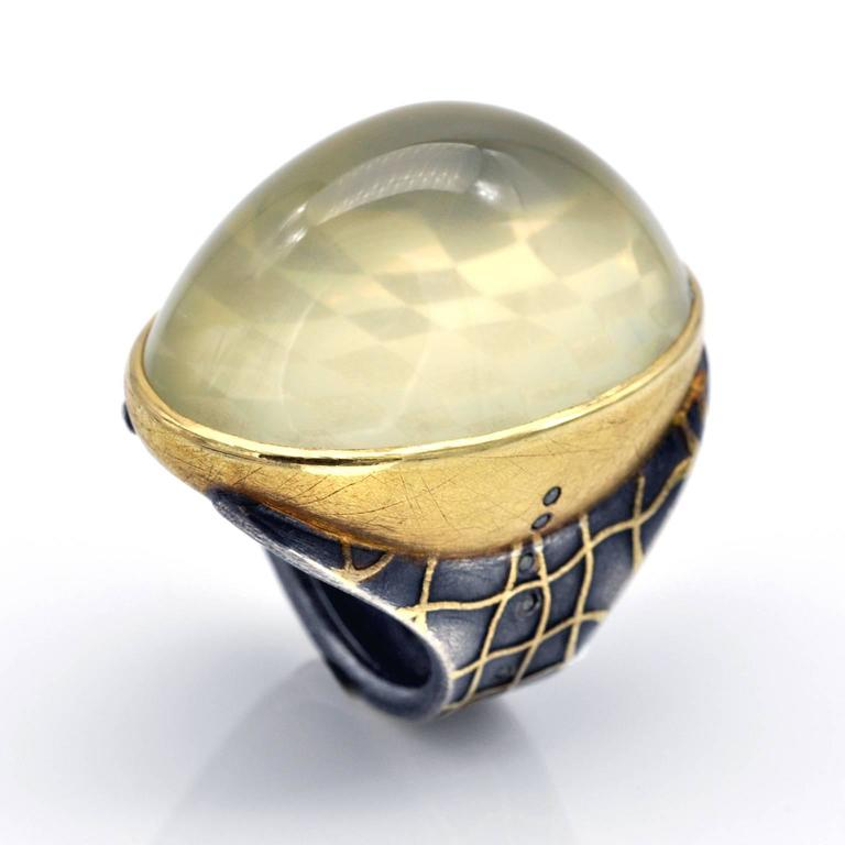 Impressive Artist Ring by Michael Zobel with a Hochstrasser-cut citrine. A checkerboard pattern and a line of diamonds reflect inside the domed citrine cabochon which has been set on top of them. The citrine being slightly 'milky' these reflections