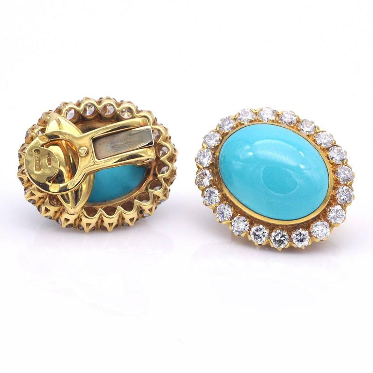 Elegant halo earrings. Twenty top quality diamonds ( color G clarity VS or better) surround each turquoise. The make and the setting of these earrings are excellent, surely made by master craftsmen.