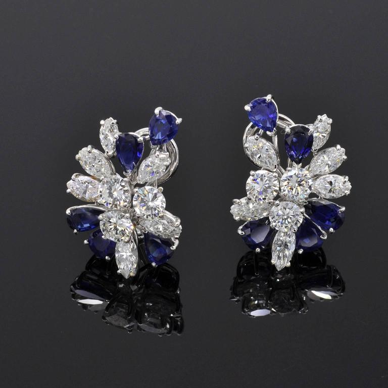 These classy earrings consists of a cluster of top quality diamonds and sapphires elegantly disposed. They are signed Missiaglia a famous italian jewelry founded in 1846 in venice. They are in perfect condition.  Details : Six round brillant cut