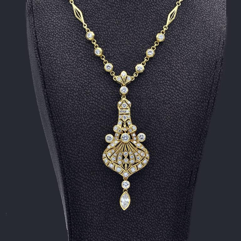 The design of this attractive  necklace has definitely oriental influences. The pendant and the chain are completely handmade. Very nice work with millegrain nicely contrasting with the biggest stone bezel setting.  Diamonds:  Approximate total
